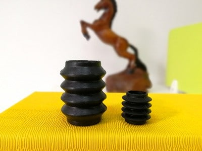 Molded convoluted rubber bellows